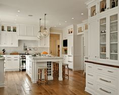 Dark wide plank flooring with white cabinets. Such a wonderful contrast