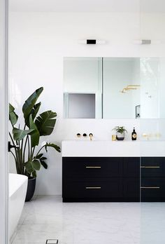 10 inspiring black and white bathrooms with incredible design and styling. From tile trends to statement lighting, we've compiled a gallery of the most incredible monochrome bathrooms. Bathroom Plants, Bathroom Spa, Basement Bathroom, Bathroom Flooring, Bathroom Furniture, Small Bathroom, Bathroom Ideas, Shower Ideas, Bathroom Faucets