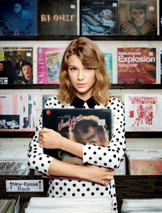 Taylor Swift with a David Bowie record