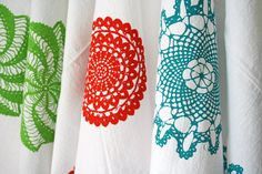 Hand-screened kitchen towels with doily designs on Etsy.