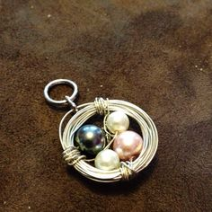 I made a bird's nest charm. Saw it here on Pinterest. Used my own chain.