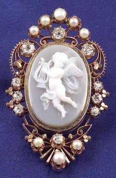 Antique 14kt Gold Hardstone Cameo, Diamond and Seed Pearl Pendant/Brooch, carved to depict a cherub playing a lyre, framed by old European-cut diamond melee and seed pearls, lg. 2 in.