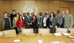 """Secretary-General With Participants in International Day for Eradication of Poverty Event  Secretary-General Kofi Annan (seventh from left) poses for a group photo with participants in the special event held today at UN Headquarters in connection with """"The International Day for the Eradication of Poverty"""" at which testimonies were given by men and women, who live in extreme poverty, from Guatemala, Haiti, the Philippines, Tanzania, France and the United States.  17 October 2005  UN, New York"""