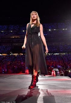 Giving back: Taylor Swift, 28, helped raise the spirits of a mourning Massachusetts community following the tragic death of a police sergeant. She was snapped taking the stage in Foxborough, Massachusetts Thursday
