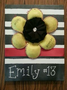 Softball player gift. Flower made from old softball, mounted on a painted canvas.  Not my creation, my daughter's.