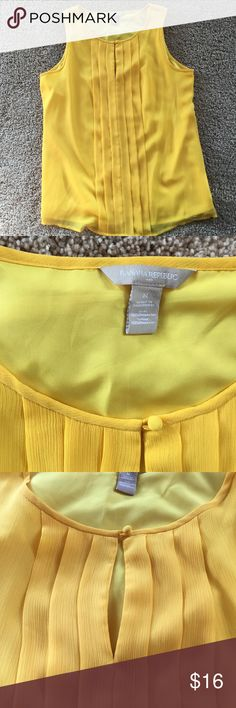 Yellow sleeveless blouse | Banana Republic Bright yellow lightweight sleeveless blouse with pleating down the front. Very comfortable and perfect for summer day at work or at play. Size M and bought at Banana Republic. Banana Republic Tops Blouses