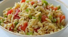 Orzo with Tomatoes and Parmesan: This tasty side dish features orzo, tomatoes and green onions seasoned with Italian herbs and Parmesan cheese.