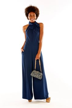 This sleeveless navy jumpsuit makes an effortless statement! It has buttons in the back and a detachable tie at the collar. It has a fitted waist, pockets, and wide legs. Imported crepe. Made in USA. Navy Jumpsuit, Halter Neck, Wide Legs, Dresses For Work, Rompers, Buttons, Pockets, Tie, Jumpsuits