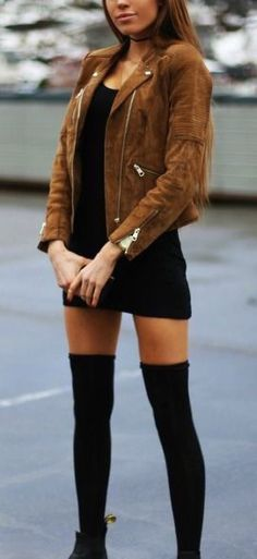 suede moto jacket over a black dress
