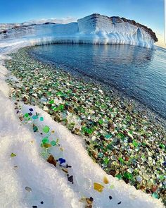 A snowy beach in Russia festooned with sea-glass.  The motion of the waves combined with the abrasion of the sand create these glass gems out of the broken glass left behind by humans