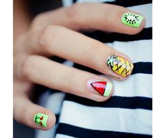 Music Festival-Inspired Nail Art: Tutti Fruiti. We can't help but smile at this cheerful mani. Intimidated? Start by painting nails one color then pick your fave fruit and focus on mastering it as a statement nail on one or both hands. #SELFmagazine #Coachella
