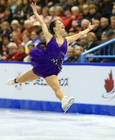 Akiko Suzuki of Japan skates during the ladies short program 2013 Skate Canada Purple Figure Skating / Ice Skating dress inspiration for Sk8 Gr8 Designs.