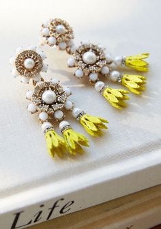 Add a little bling to your look with our white and yellow vintage inspired drop earrings | Banana Republic