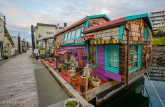 Victoria, Canada - March 2017: Love this colorful boat house among all other original boat houses in this harbor town.