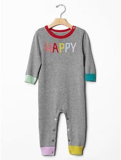 Happy rainbow sweater one-piece. Pharrell called. He wants a new version of the video. With babies wearing this. Oh yes.