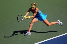 Lucie Safarova of Czech Republic stretches to play a backhand against Aleksandra Wozniak of Canada during their women's singles second round match on Day Three of the 2012 US Open