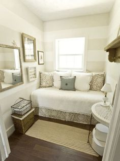 Love this, small but cozy guest room, function as a little study if theres room for a desk, nice sofa to read on.