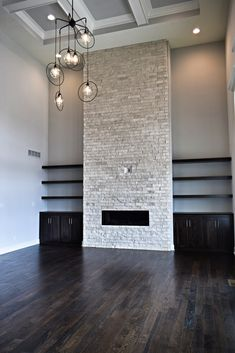 Two Story Stone Fireplace, Great Room Fireplace, Built In Shelves, Great Room Lighting, Coffered Ceiling