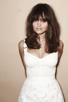 Jenna Coleman in a white dress