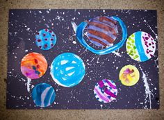 Solar system craft for kids:  draw circles; paint them; cut them out.  Splatter paint on dark paper then glue the circles on.