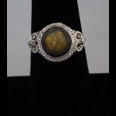 New Malagasy Labradorite Ring in Sterling Silver 3.39 cts Genuine Malagasy Labradorite Ring made in 925 Sterling Silver ring setting.  Stone has a green/gold tone that changes with the light.  New in original package, never worn. Jewelry Rings