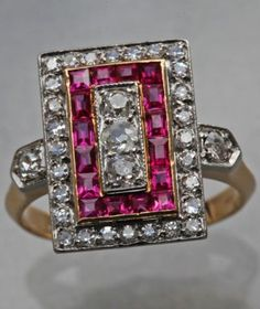 An Art Deco gold, ruby and diamond ring, French, circa 1930. With French owl import and indistinct maker's mark.