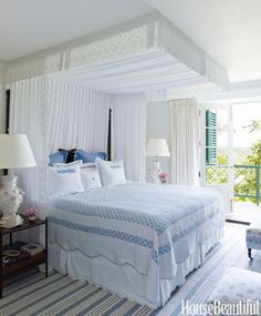 In Amanda Lindroth's Bahamas house, a ceiling-high canopy of white eyelet is a grand gesture in a guest room. Bed linens, Matouk.   - HarpersBAZAAR.com