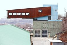 Crazy home in Pittsburgh - 53 foot long glass & steel structure cantilevered over the owners glass factory. Insane!!