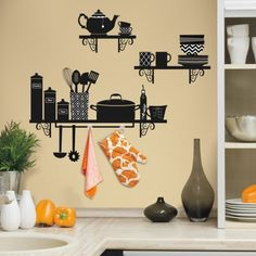Build a Kitchen Shelf peel and stick wall decals includes removable shelves, pots, pans, cups and more to create a kitchen silhouette on your wall. Includes hooks for handing ovenmits and towels.