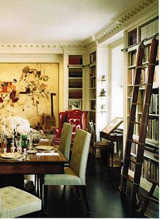 Love the ladder with the built in bookshelves around the dining room table