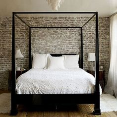 Gorgeous white bedroom with brick backdrop by leona