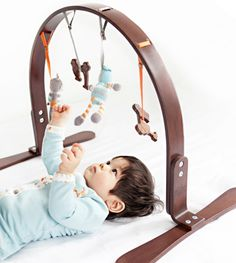 cute wood play gym - I love that its wooden because there is soooo much plastic in baby land, too much IMO.