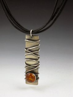 Amber Necklace by Michele Grady, via Etsy.