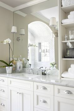White bathroom, built in shelves.