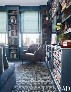 By far the dominant color in this sophisticated library, this deep blue hue feels masculine and sophisticated.