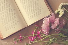 This doesn't highlight the book as much, but here's a good composition with the flowers and the book together.