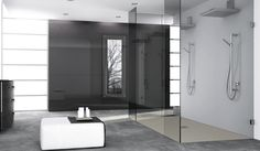 A flush fitting Fiora Silex shower tray has been combined with a large frameless glass walk-in shower screen to create this simple but elegant wetroom