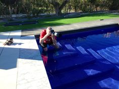 Photographer in the pool - not as warm as it looks! www.kiniki.com