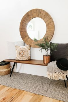 oversize round wood mirror with a midcentury modern style bench and cozy pillows and throws to add warmth(Mix Wood Living Room) Home Decor Inspiration, Room Decor, Decor, House Interior, Furniture, Home, Interior, Round Wood Mirror, Home Decor