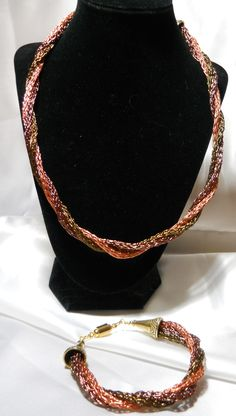 This is a 22 inch Viking Knit Tri Strand that is twisted.  Done in Copper, Burnt copper and Burnt gold colored wire.  With a 8 inch Bracelet to match.  Check me out at www.disheritagejewelry.weebly.com