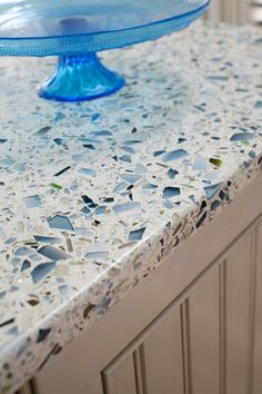 Recycled glass countertop! Sooooooo perfect! Heat resistant so you can sit dishes on it straight from the oven, you can cut on it, and it doesn't stain or hold bacteria like granite and concrete countertops! Hmmm...