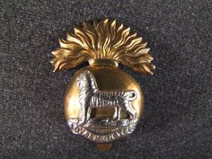 Royal Munster Fusiliers cap badge, £35