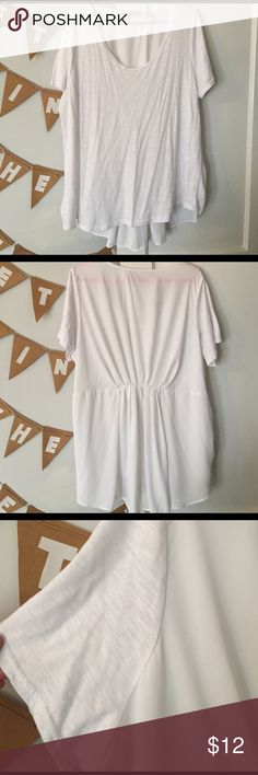 Flirty white tee Casual tee in the front, flirty long silky pleated back. Perfect for upping your jeans and tee style! Worn once. Brand is Roamans, listed as Lane Bryant for exposure Lane Bryant Tops Tees - Short Sleeve