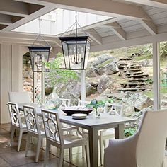 Beams were removed to bring in more light from above in this dining room, while a slender, 12-foot-long wooden table with a beveled zinc top was custom-made to fit the narrow space.