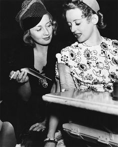 Joan Blondell visiting Bette Davis on the set of Dark Victory, 1939