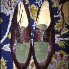 Vintage Gucci Oxfords never worn size 7 b These are vintage Gucci oxfords in brown leather and green suede. The shoes are a size 7b. There are some scratches on the sole, but these have never been worn out of the house. Please note that there is a scuff on the toe, please see second picture. Gucci Shoes Flats & Loafers