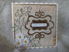 Holly flourish with white flowers and gold frames. Perfect with a simple backing paper.