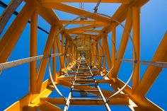 Low angle view of a crane ladder against Low Angle, Royalty Free Pictures, Crane, Fair Grounds, Stairs, Sky, Ladders, Explore, Architecture