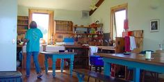 Isle of Iona Youth Hostel. This captures so much of what i love in a space-open shelving, wood floors, a big farm table, and windows that look out onto the ocean.