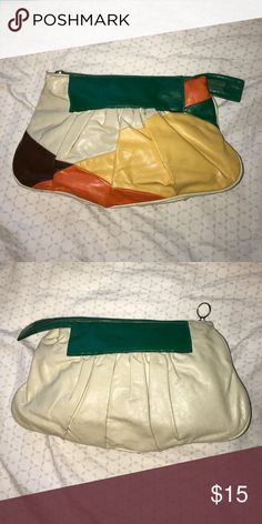 Multicolored Large Clutch Zip Closure. Zip Closure pocket inside as well. On the larger side and has plenty of space for storage. Used but still has plenty of life. Bags Clutches & Wristlets